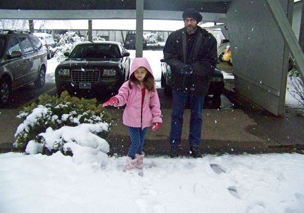 Anna and Dad out in the snow