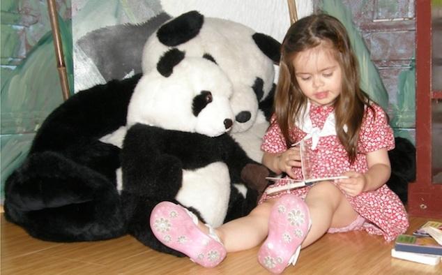 Anna reads to pandas
