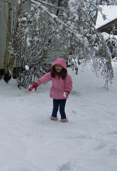 Anna throws a snowball.