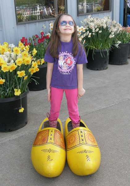 Anna in oversized wooden shoes.