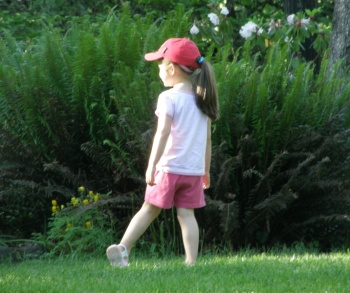Anna walks through the grass at Hendricks Park in May 2009