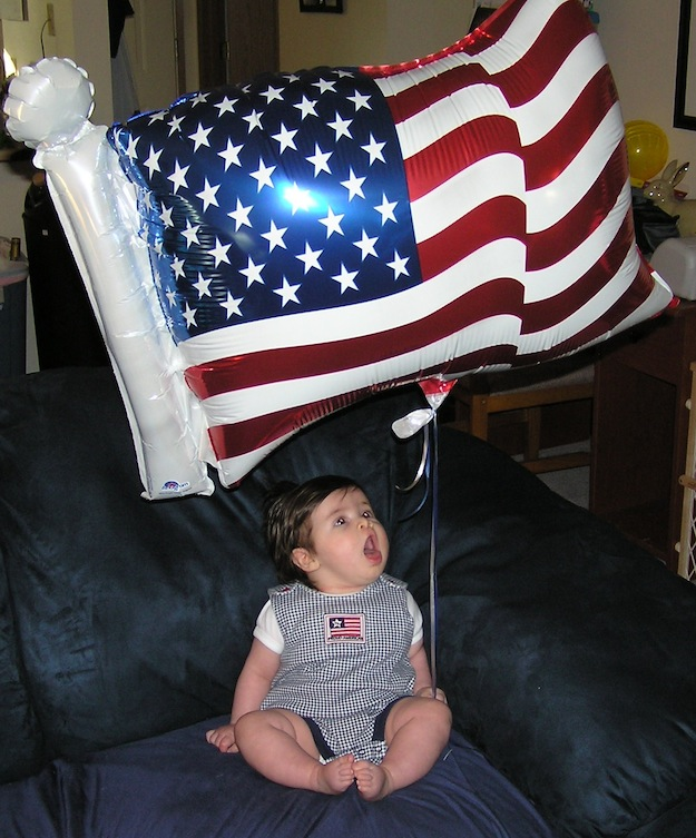 Baby Anna with a flag balloon on July 4th, 2006