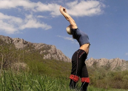 Stretching woman in Crimea.
