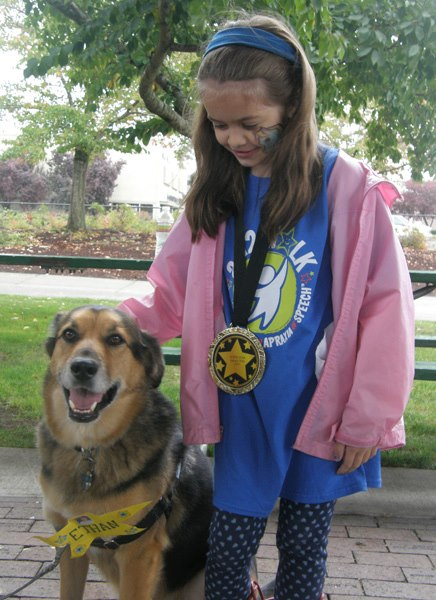 Anna and a dog at the Salem Apraxia Walk
