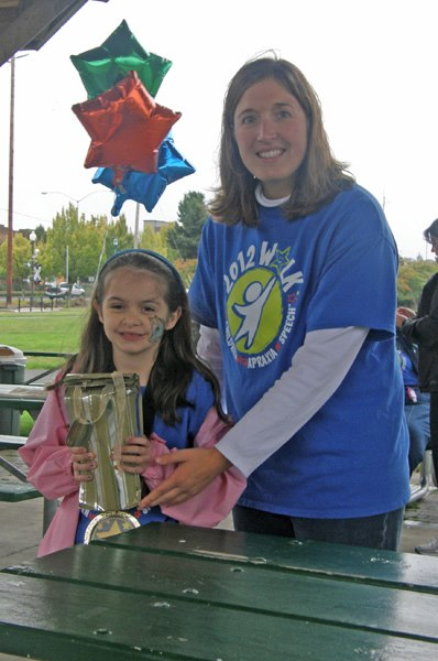 Anna accepts Team Anna's prize for top fundraising team.
