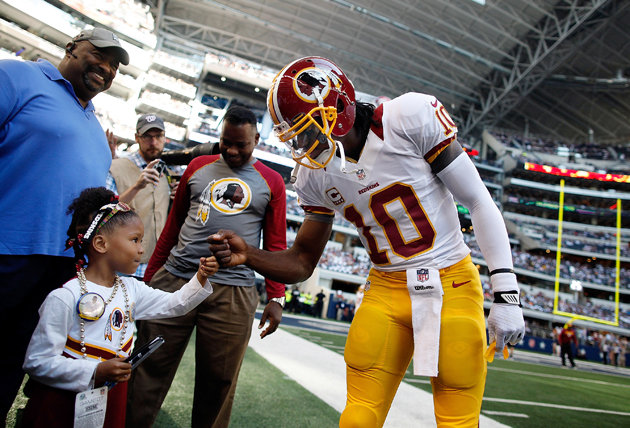 RG3 fist-bumps with a kid