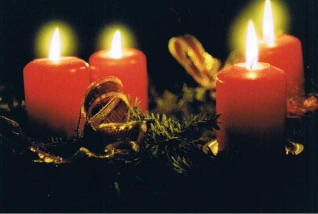 Four lit Advent candles
