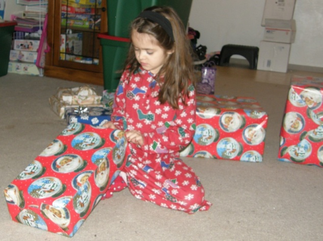 Anna opens gifts on Christmas morning