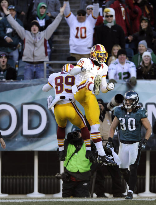 Santana Moss, left, and Josh Morgan celebrate after Moss' touchdown