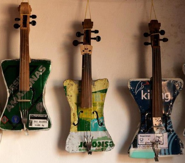 three violins made from recycled trash