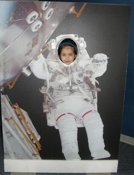 Anna in an astronaut cutout photo at OMSI