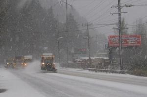 Snow plows work in tandem on U.S. 30