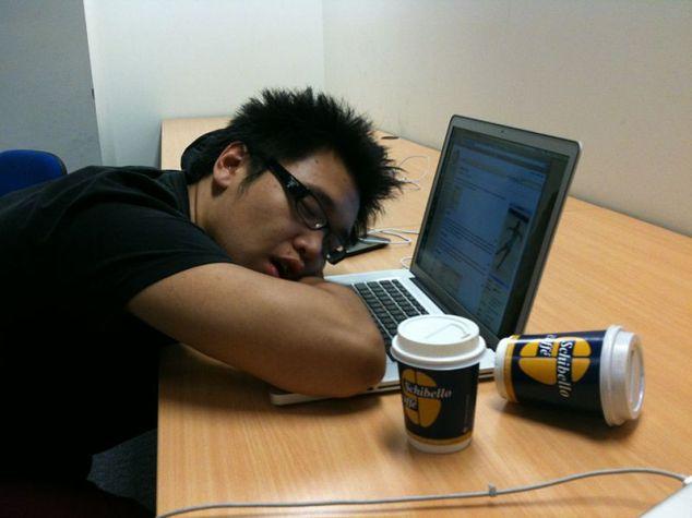 Man asleep at laptop computer.
