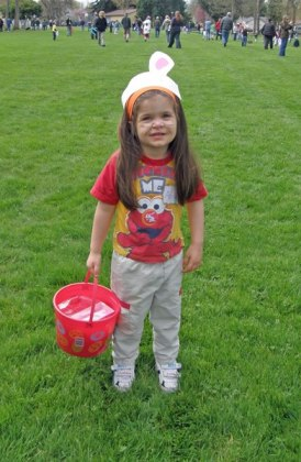 Three year old Anna with egg bucket