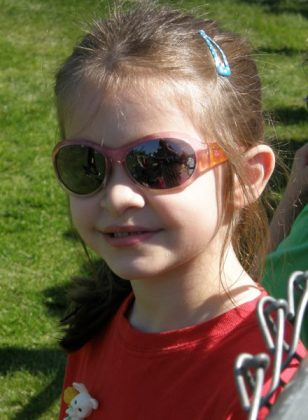 Seven year old Anna in sunglasses.