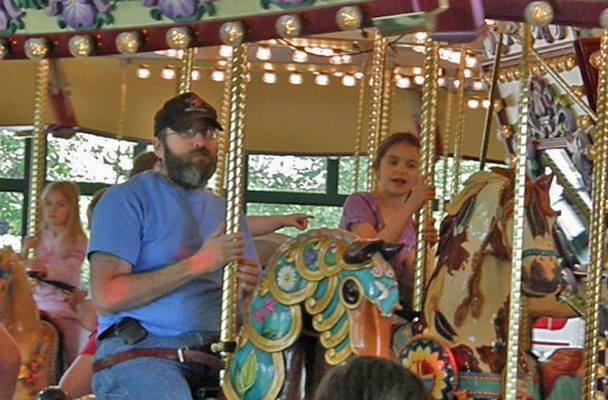 Riding the same carousel at age seven