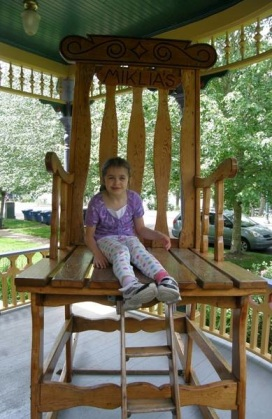 On the same chair at age seven