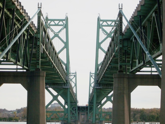Between the two spans of the I-74 bridge.