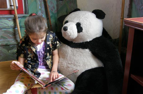 Anna reads to the same Panda at age seven