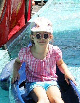 Anna rides a canoe