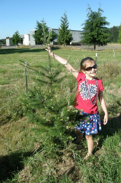 Anna next to the tree in 2013