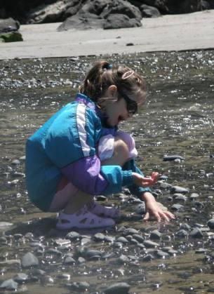 Anna looks at rocks.