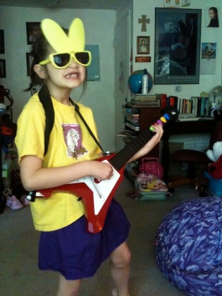 "Anna with Flying V ""guitar"" and bunny sunglasses"