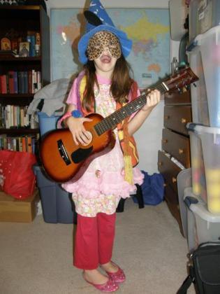 Acoustic guitar, cheetah mask, wizard hat, etc.