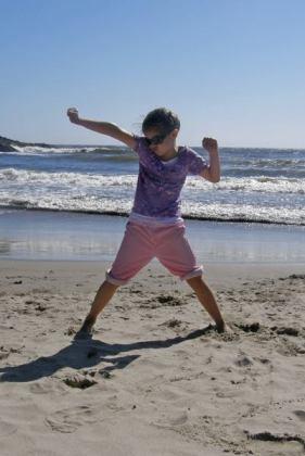 Anna strikes a pose on the beach last summer.