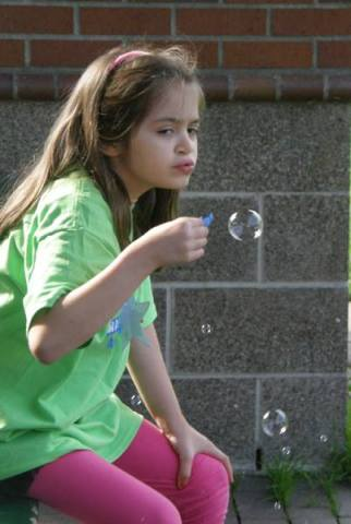 Anna blowing bubbles