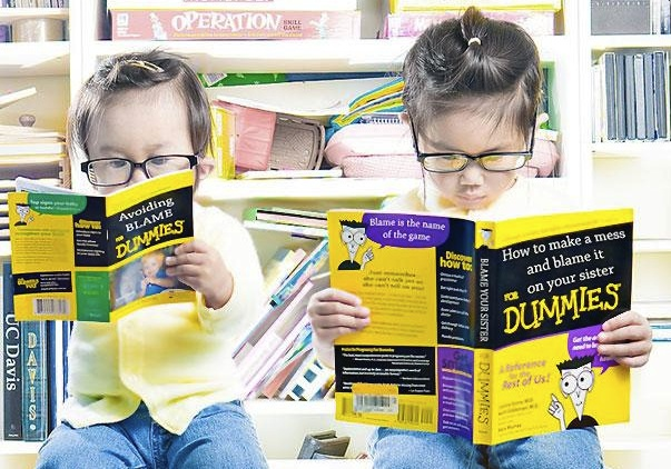 Two girls reading.