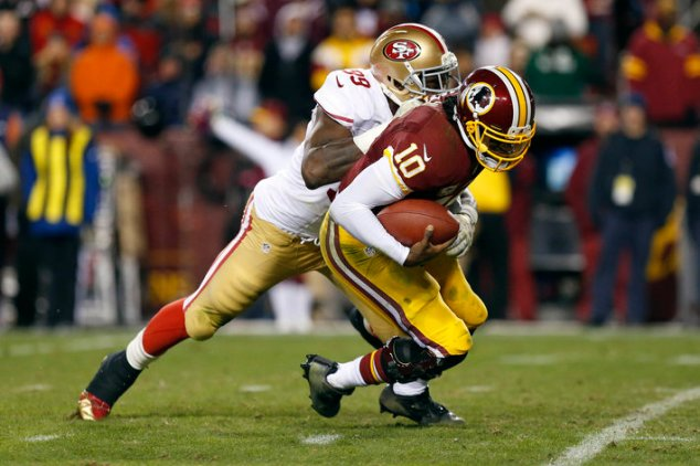 Robert Griffin III (10) is sacked by San Francisco 49ers outside linebacker Aldon Smith (99)