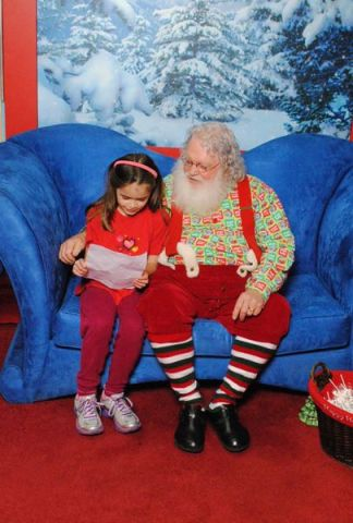 Anna reads her list to Santa