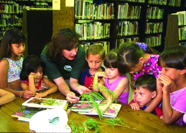 Martha Artega, NRCS Public Affairs Specialist, works with children on a conservation education project in Roma, TX. [Slide 97CS3024]