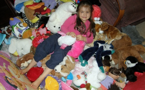 4 y.o. Anna on a pile of stuffed animals