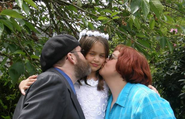Julia and I kiss Anna after her first communion.