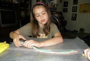 Twisting clay.