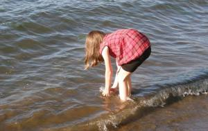 Anna collects water from the Columbia River