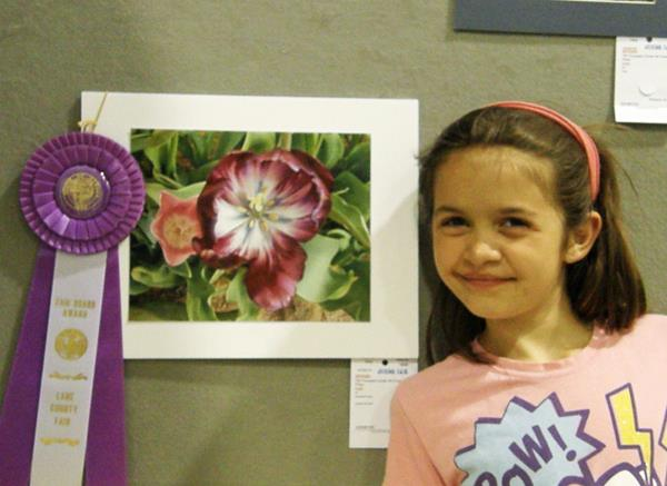 Anna and her tulip photo with ribbon