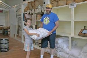 Anna and I with a 25 lb. sack