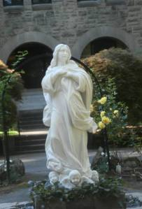A statue of Mary in front of the monastery.