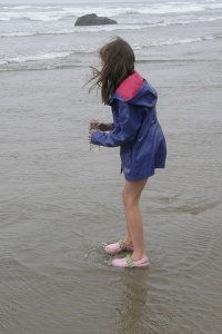 Anna on the beach collecting water.