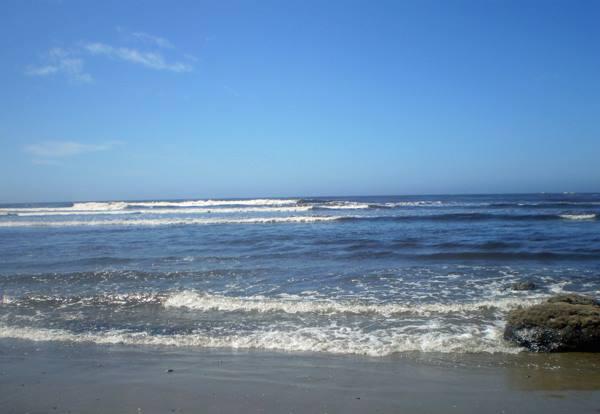 Waves breaking on a beach.