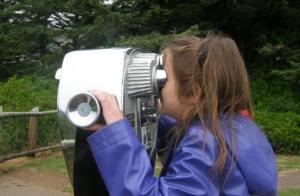 Anna looks through a viewfinder.