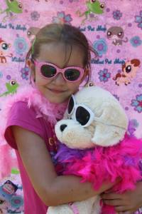 Anna and plush dog with sunglasses