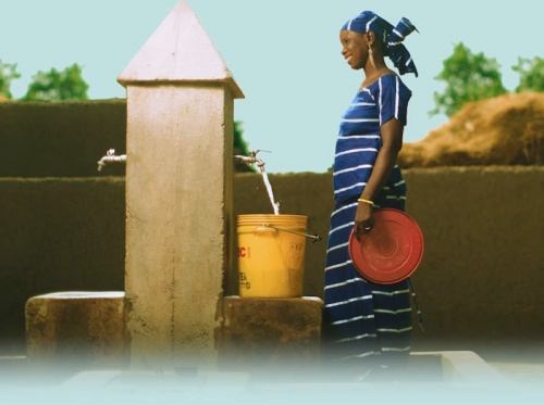 Woman at a water tap