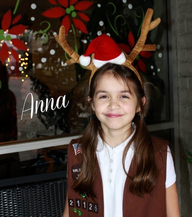 Anna in her vest and reindeer antlers.