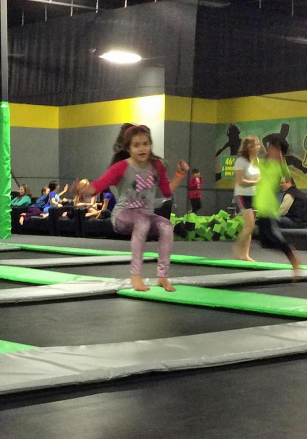 Anna bouncing on a trampoline.
