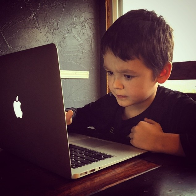 Parker at his dad's laptop.
