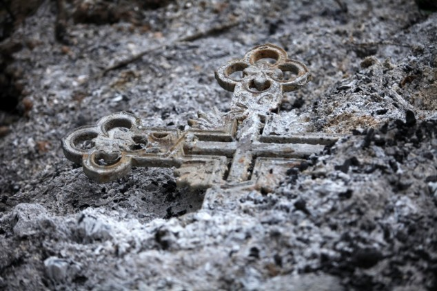 A cross amidst ashes.